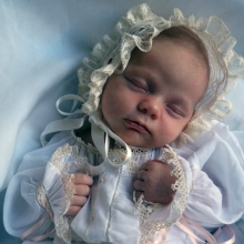 A beautiful gown created by her Grandmother. 1 month old.
